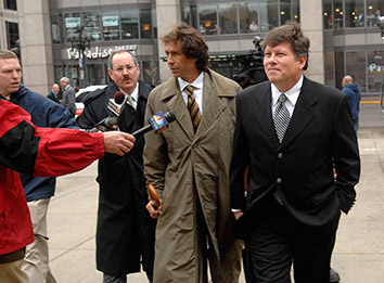 Tim Durham, right, arrives for a court hearing April 11