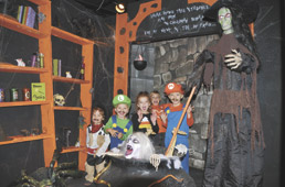 Kids enjoy 'Wicked Workshop' during IPL-sponsored lights-on hour at The Children's Museum.