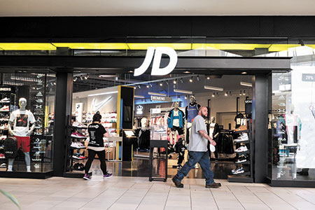 British retail giant that bought Finish Line is taking slow approach to U.S. market